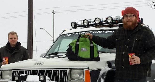 First place Max King pictured with his buddy, his Jeep and Off Road Addiction bag containing a whack of prizes. .jpeg