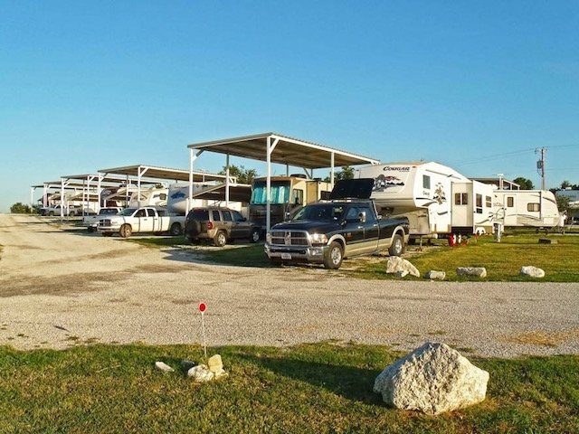 26-west-gate-rv-park-poolville-texas-fort-worth-weatherford-mineral-wells-covered-awning-full-hook-up-campsites.jpeg