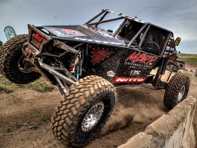 Getting up close and personal while shooting Loren Healy at the Ultra4 Stampede.jpg