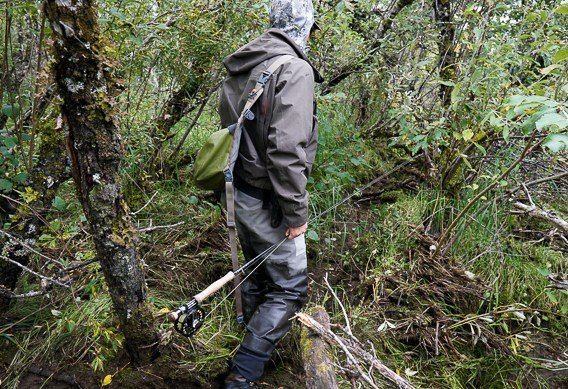 Walking-through-brush-with-fly-rods-hold-the-middle.jpg