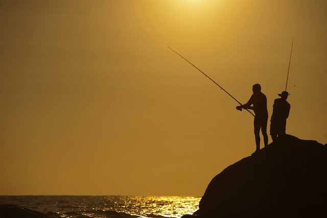 Fishing Backlit Beach