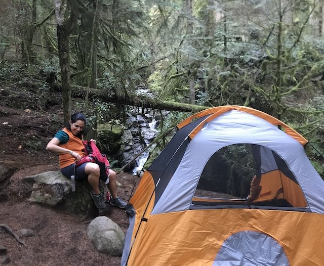 Nora setting-up tent on host property. .jpg