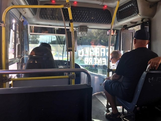 Inside the white no a:c and hard seat buses. Notice the 'Sabalo Centro' painted on the front windshield. This tells you the route.JPG