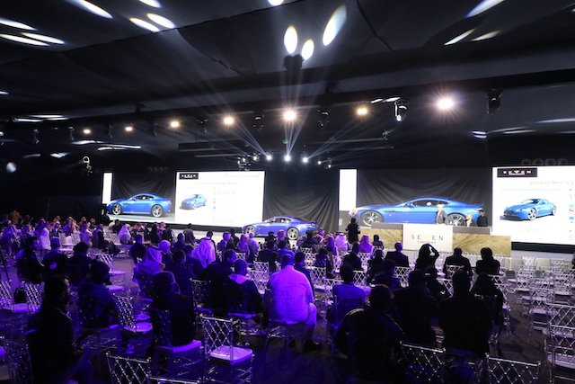 6 Big screens, bright lighs and empty chairs for the exotic car auction.JPG