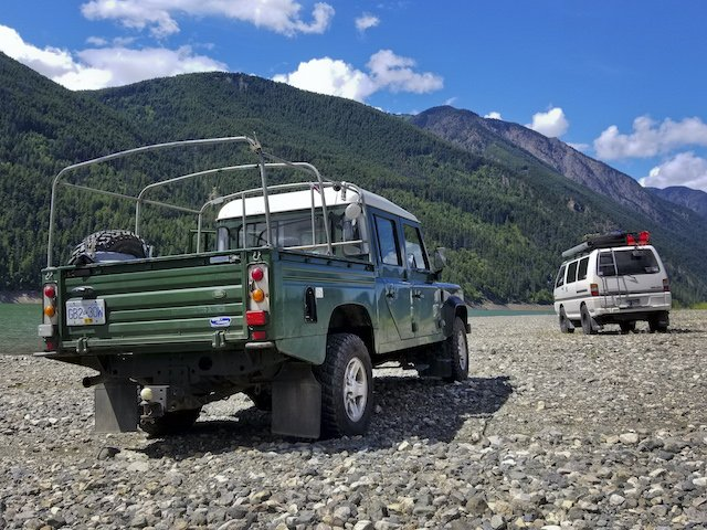 Land Rover Defender 130 and Mitsubishi Delica at Cameron Lake