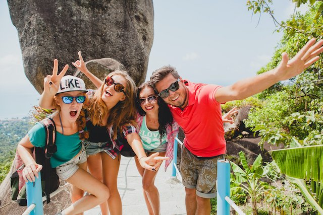 happy hipster company of friends traveling around world, sightseeing, cool outfit, colorful, crazy, having fun, laughing, smiling, tropical vacation in thailand, students, sunglasses, sunny, summer