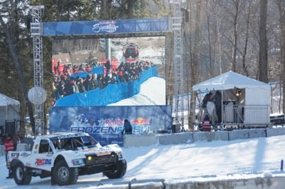 Big screens everywhere for race coverage photo Perry Mack.JPG
