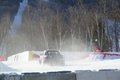 Clouds of snow and exhaust cover the race course photo Perry Mack.JPG