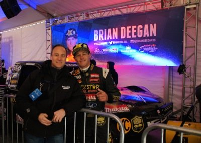 Perry Mack in the pits with driver Brian Deegan photo Perry Mack.JPG