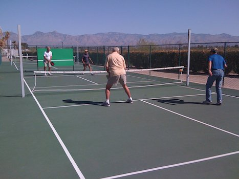 A pickleball court is 20 feet by 44 feet for both singles and doubles matches. The net across the middle of the court is 34 inches high in the middle of the court and goes up to 36 inches at each end.