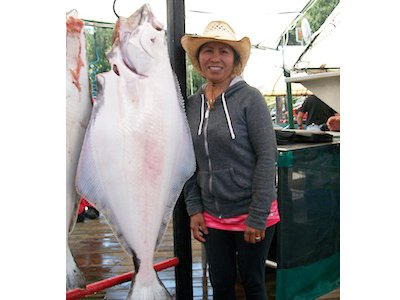 Dixie Maul with her 57 lb Halibut